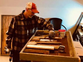 John working on a Minneapolis Barnwood Skyline