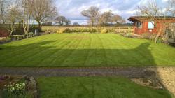 View across freshly mowed lawn