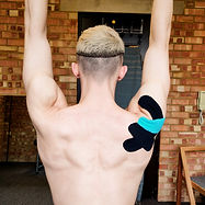 Rotator cuff kinesioogy taping, sports massage techniques for pan relief and movement restriction