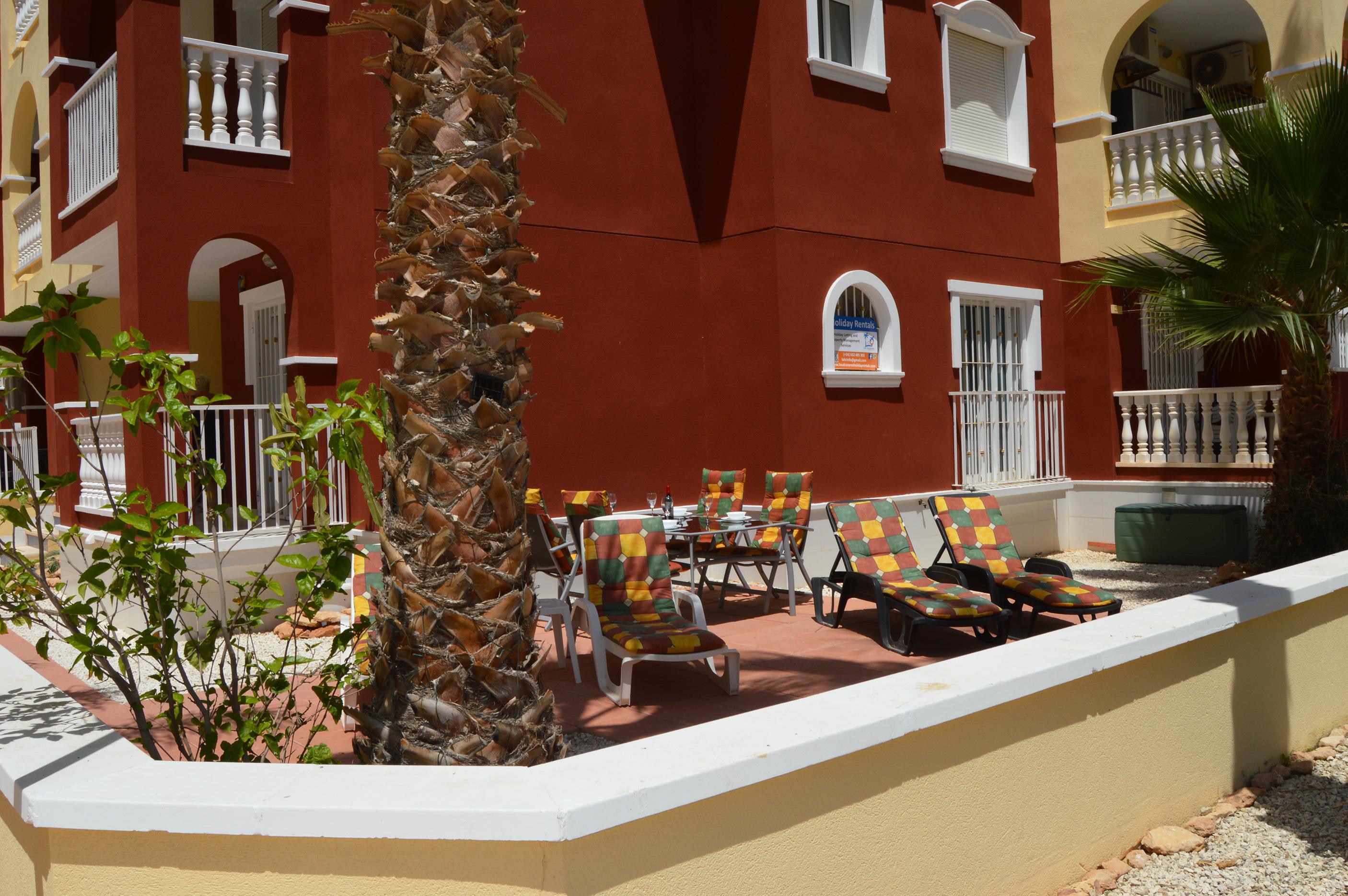Huge outdoor terrace overlooks pool