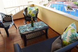 Outdoor terrace overlooking pool