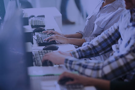 Header image of person typing on keyboard at desk.
