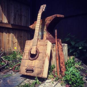 Reclaimed 'barn wood', horse shoe, mahogany.