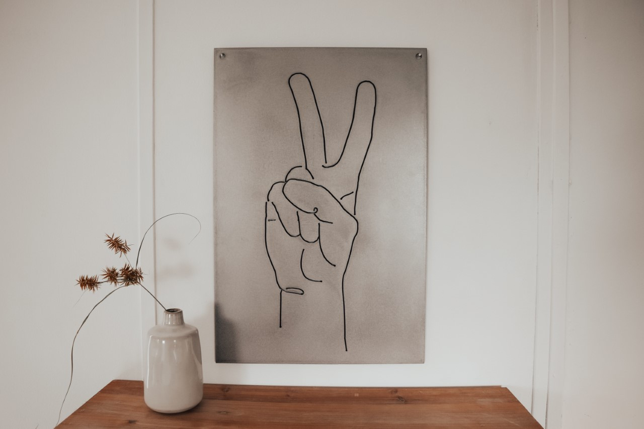 peace sign white wall.jpg