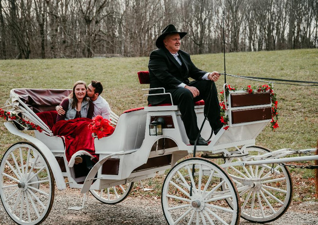 Jesse and danielle in carriage 1.jpg