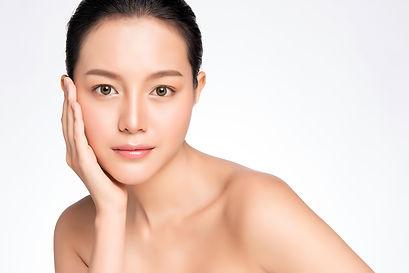 Beautiful Young asian Woman touching her