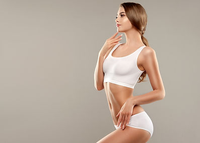 Perfect slim toned young body of the gi