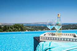 Enjoy a glass  by the infinity pool