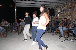Greek musicians and dancers entertain the wedding party