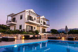 Villa from the pool area at sunset with the white mountains in the background