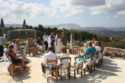 Intimate wedding ceremony on the patio by the pool