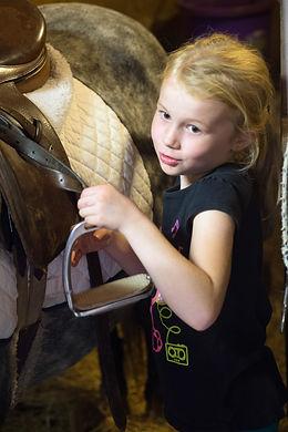 Child Tacking up Horse