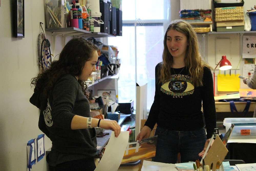 Emma Fenton (right) discusses an art project with a student at C.R.E.A.T.E. Community Studios in Saratoga Springs