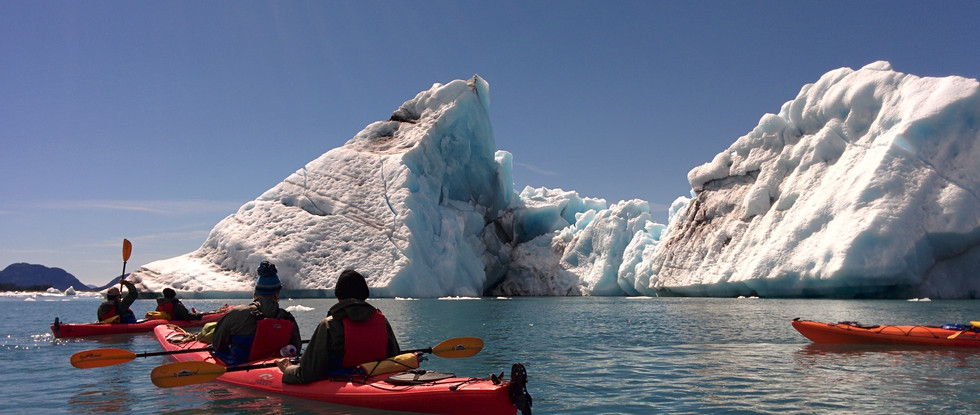 Kayaking in Columbia Bay, where massive icebergs breaking up from the fastest receding glacier in Alaska, Columbia Glaicer, Prince Williams Sound. Photo by Ido Gayer.
