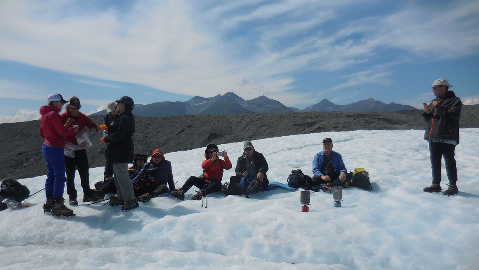 Finding time to eat lunch and drink hot choclate on Root Glacier. Photo by Ido Gayer