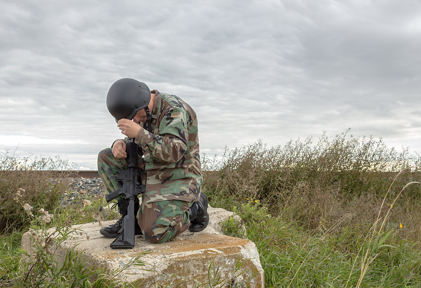 horizontal image of a soldier kneeling d