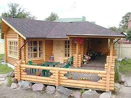 maison rondin avec terrasse.JPG