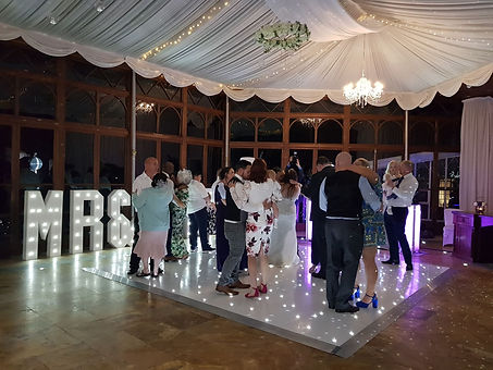 light up name initials at wedding reception