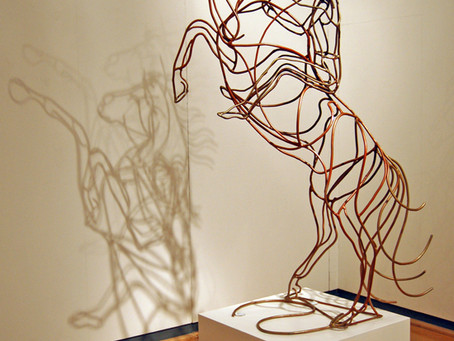 AMY GOODMAN - EQUESTRIAN SCULPTOR - HAS A UNIQUE STYLE IN WELDED STEEL, BRONZE AND DISTINCTIVE INK.