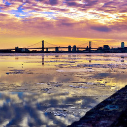 A view of the Benjamin Franklin Bridge over the icy Delaware River