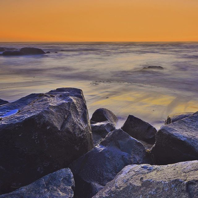 My take on the long exposure beach sunset with the rocks in the foreground shot