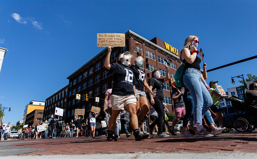 Protesters chant during a march standing with victims of police brutality June 13 downtown Grand Rapids.