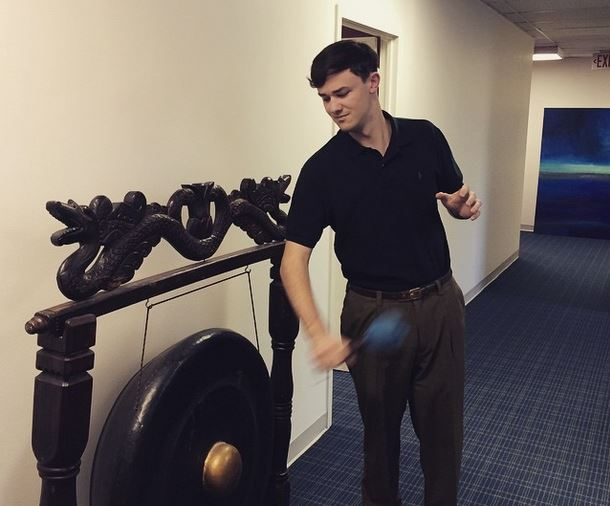 Tim rings the gong