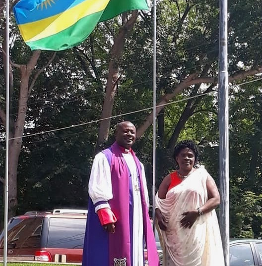 2019 ICA Archbishop & Elect Lady Nshimiyimana & the flag of Rwanda