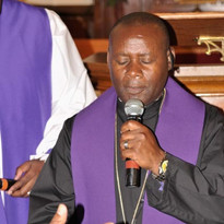 2017 ICA Bishop Nshimiyimana praying for candidates