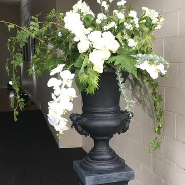 event-entrance-florals-black-urns.JPG