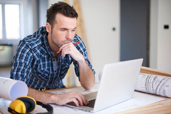 worker-using-laptop-in-the-office.jpg