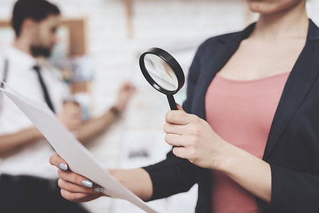 woman-is-posing-with-paper-magnifying-glass.jpg