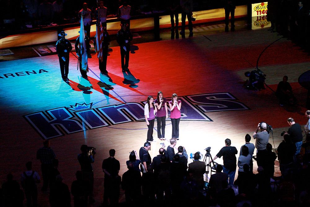 Christina, Katherine, and Lisa Cimorelli singing the National Anthem in 2008