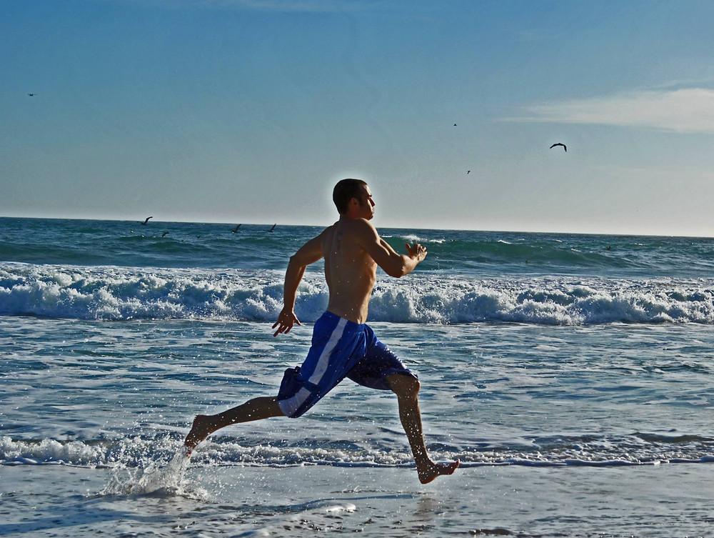Michael running on the beach