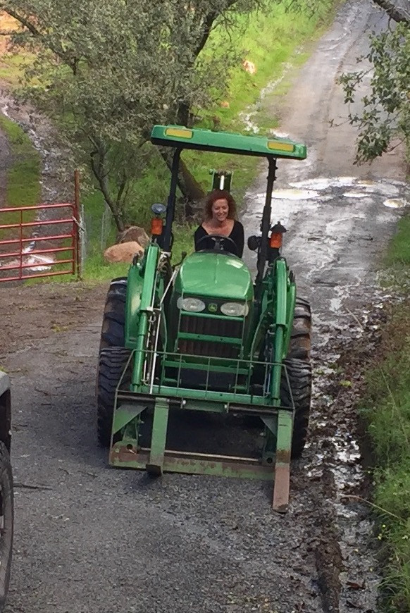 Cherie on a tractor