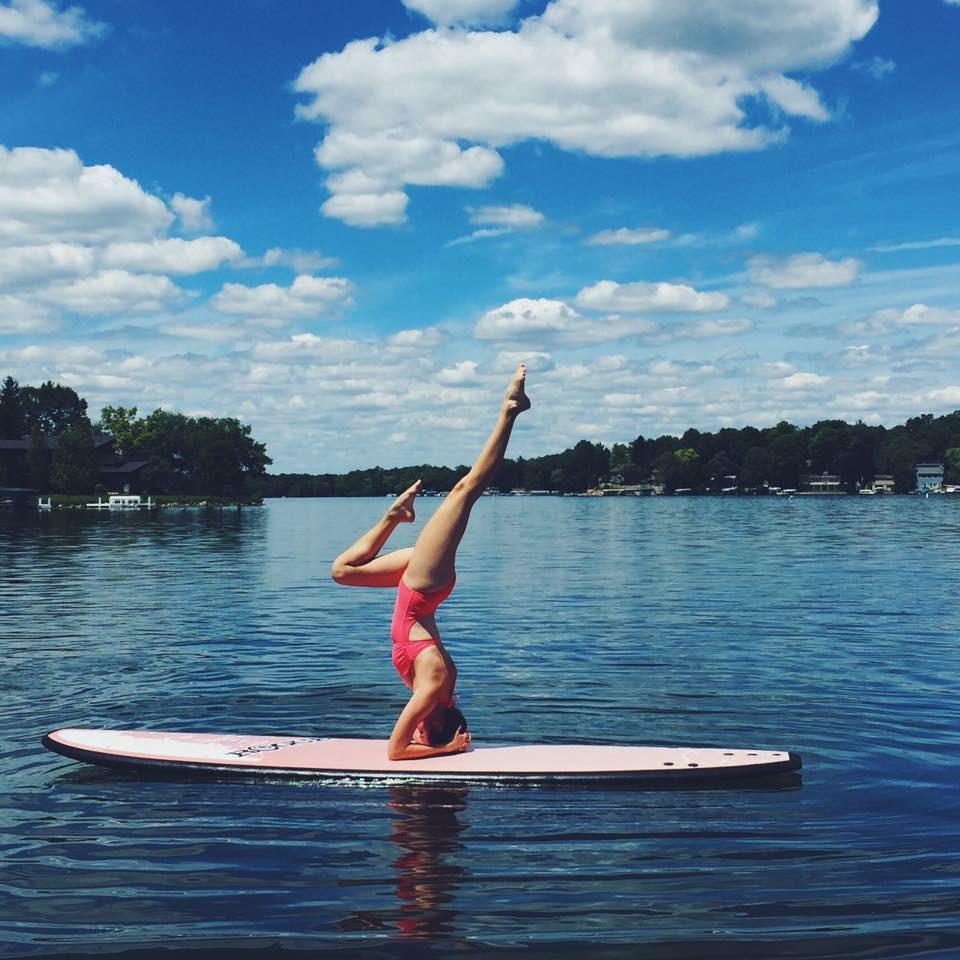 Christina handstand on paddle board