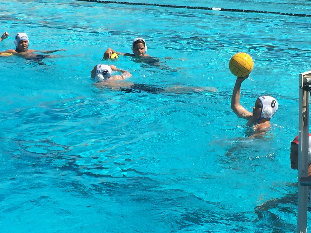 Christian playing water polo