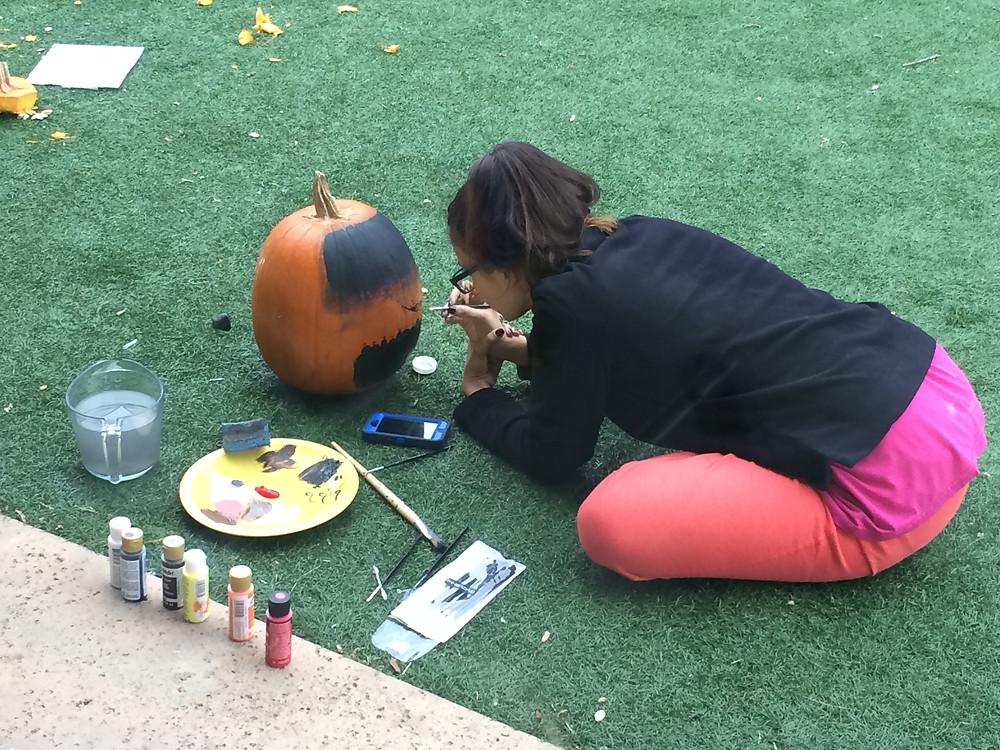 Lisa painting a pumpkin
