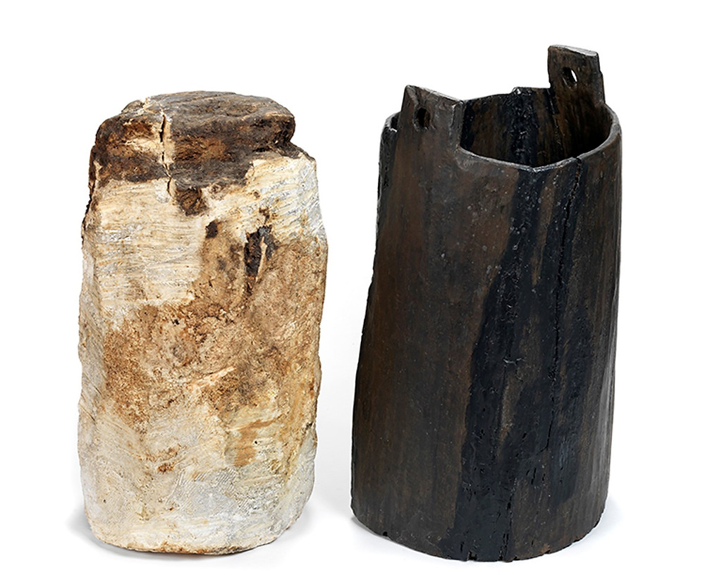 Cylinder of pale solid substance and dark wooden jar