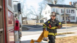 Firefighter running to fire