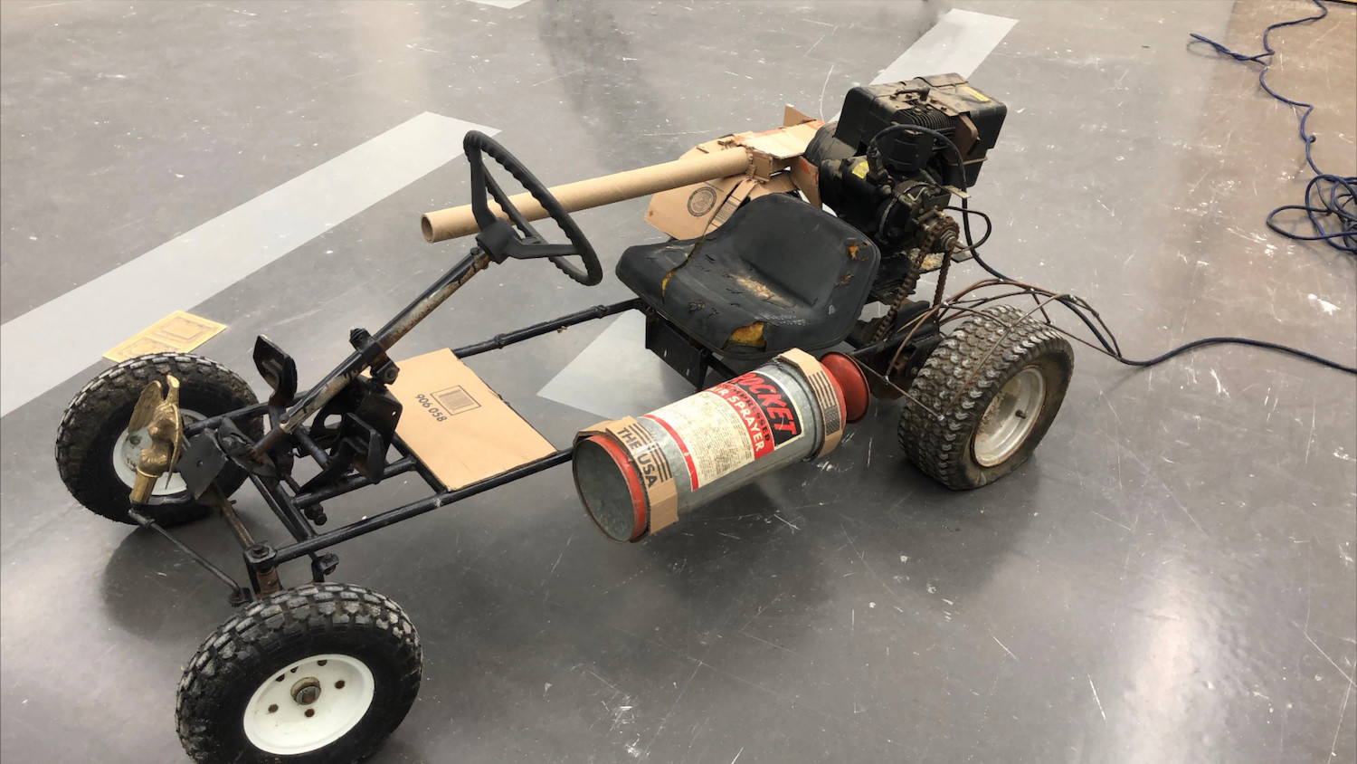 Go- Go-Go Getting the fuck out of here kart, Found Object and Carboard, 2' x 5' x 2', 2020