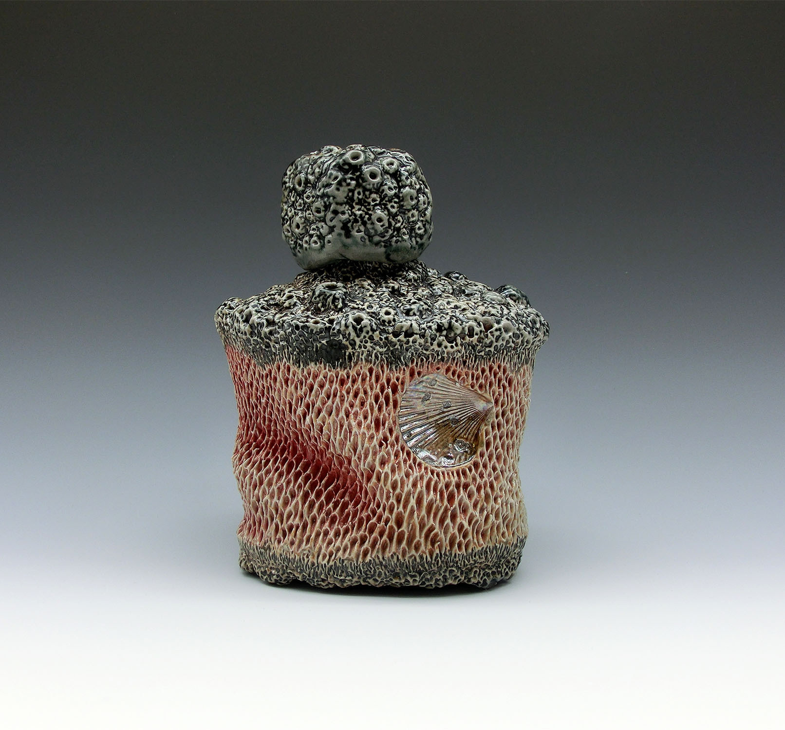 Siren's Vice 1, Domestic porcelain, black slip, mason stain, mother of pearl luster, glaze, cone 10 atmospheric fired, 6x4x2.5, 2020