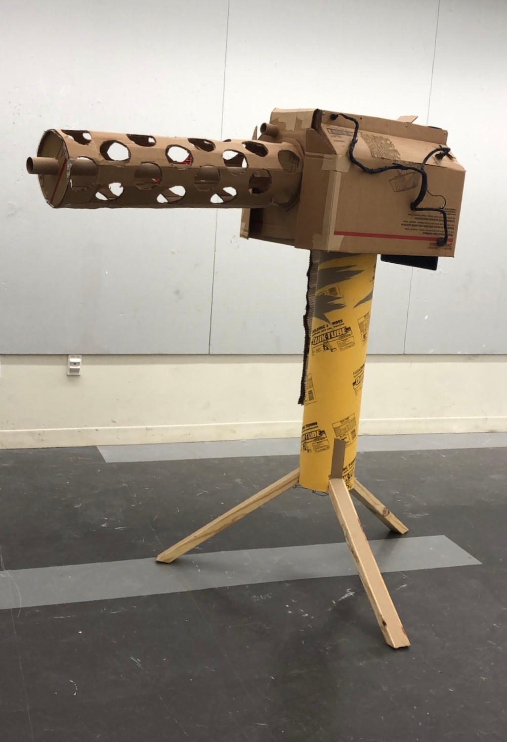 Found objects, carboard, wire, laptop, camera and wood, 5' x 3' x 3'