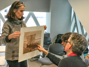 Viewing a portfolio photogravure from the NAI
