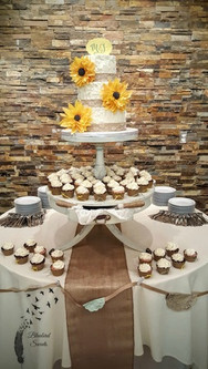 Rustic buttercream wedding cake with sunflowers and burlap