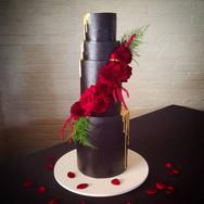 Black Moody wedding with burgundy floral