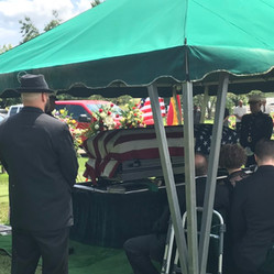 Casket laid on the grave