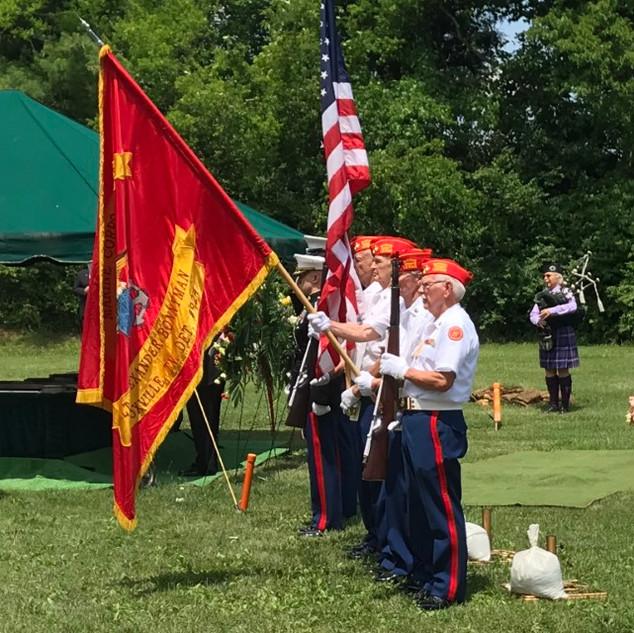 Honor Guard salute the casket