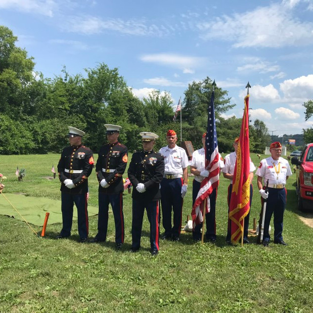 Honor Guard standing by at the grave site