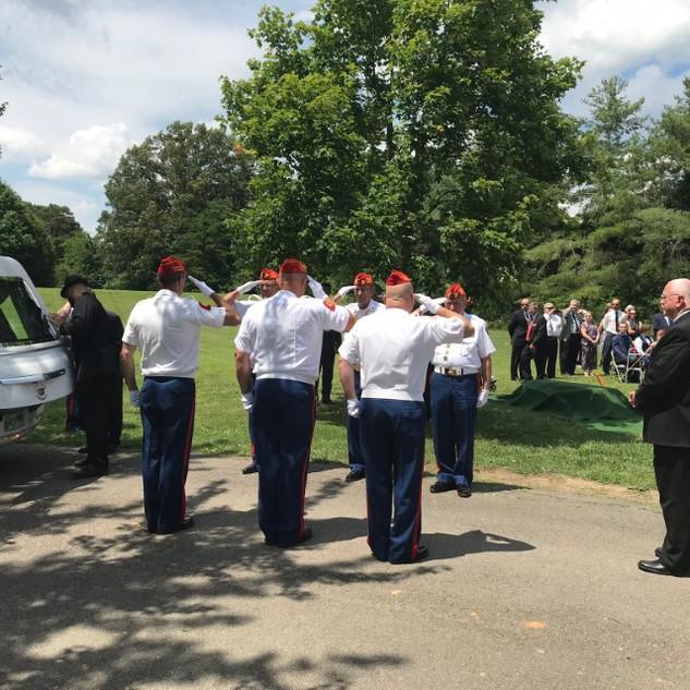 Pall Bearers salute Joe's casket